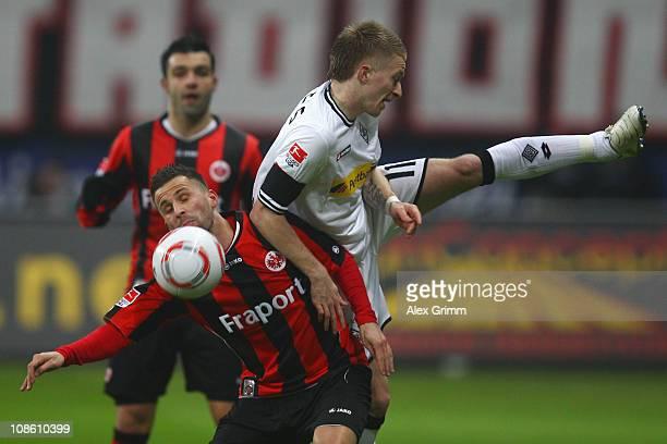 Benjamin Koehler of Frankfurt is challenged by Marco Reus of M'Gladbach during the Bundesliga match between Eintracht Frankfurt and Borussia...