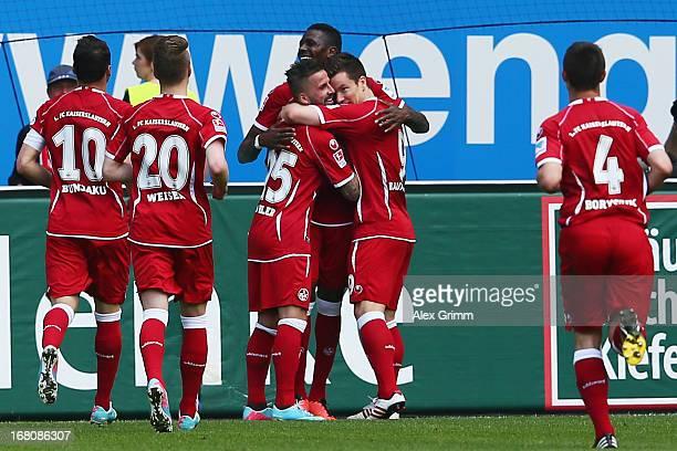 Benjamin Koehler of Kaiserslautern celebrates his team's third goal with team mates during the Second Bundesliga match between 1 FC Kaiserslautern...