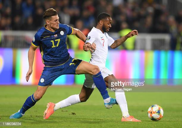 Benjamin Kololli of Kosovo tackles Raheem Sterling of England during the UEFA Euro 2020 Qualifier between Kosovo and England at the Pristina City...