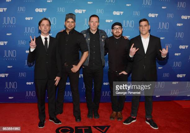 Benjamin Kowalewicz Ian D'Sa Aaron Solowoniuk Jordan Hastings and Jonathan Gallant of Billy Talent arrive at the 2017 Juno Awards at Canadian Tire...