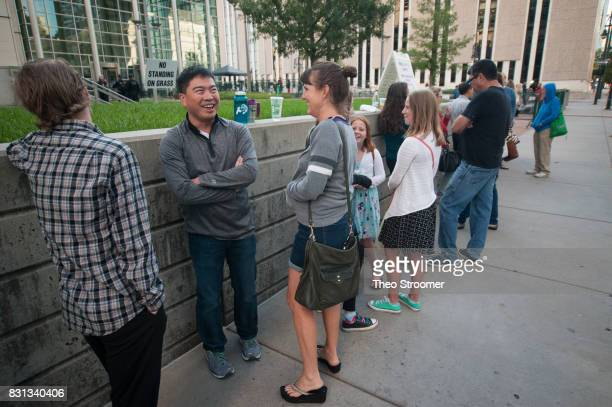 Benjamin Kuo and Anne Gordon share a laugh while waiting in line for spectators' seats during the civil case for Taylor Swift vs David Mueller at the...