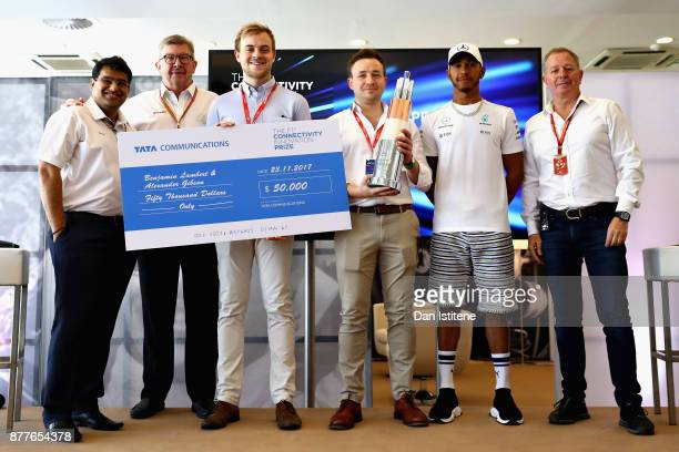 Benjamin Lambert and Alexander Gibson are presented with the Grand Prize by Mehul Kapadia, Ross Brawn, Managing Director of the Formula One Group,...