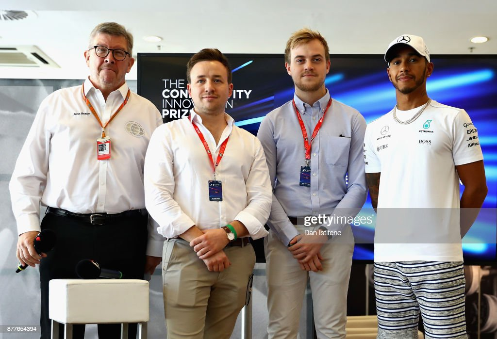 Benjamin Lambert and Alexander Gibson are presented with the Grand Prize by Mehul Kapadia, Ross Brawn, Managing Director (Sporting) of the Formula One Group, Lewis Hamilton of Great Britain and Mercedes GP and Martin Brundle at the F1 Connectivity Innovation prize giving at Yas Marina Circuit on November 23, 2017 in Abu Dhabi, United Arab Emirates.