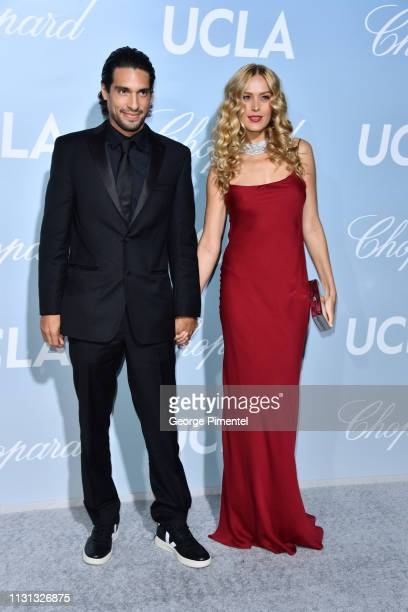 Benjamin Larretche and Petra Nemcova arrive at the 2019 Hollywood For Science Gala at Private Residence on February 21 2019 in Los Angeles California