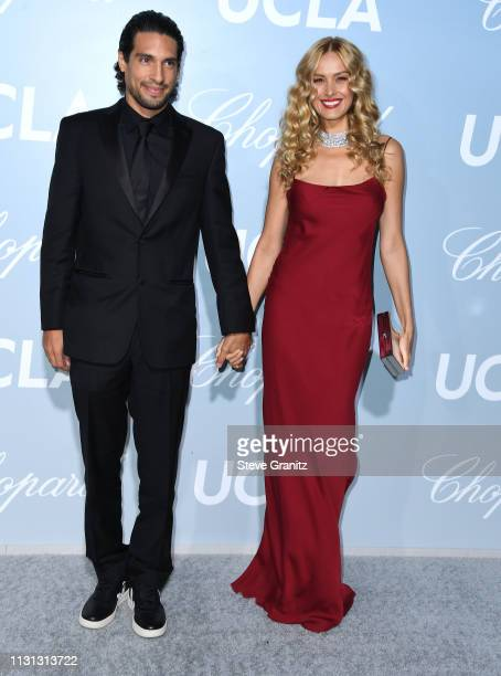 Benjamin Larretche and Petra Nemcova arrive at the Hollywood For Science Gala at Private Residence on February 21 2019 in Los Angeles California