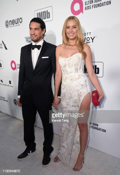 Benjamin Larretche and Petra Nemcova attend the 27th annual Elton John AIDS Foundation Academy Awards Viewing Party Celebrating EJAF And The 91st...