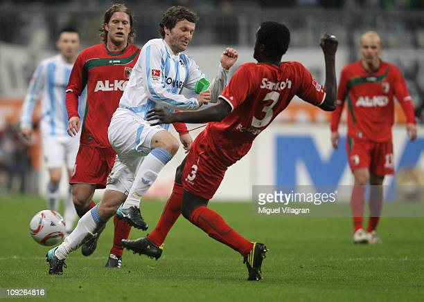 Benjamin Lauth of 1860 Muenchen fights for the ball with Gibril Sankoh of FC Augsburg during the second Bundesliga match between 1860 Muenchen and FC...