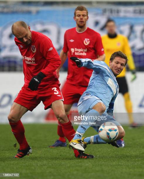 Benjamin Lauth of 1860 Muenchen fights for the ball with Ivica Banovic of Energie Cottbus during the German second league match between 1860 Muenchen...