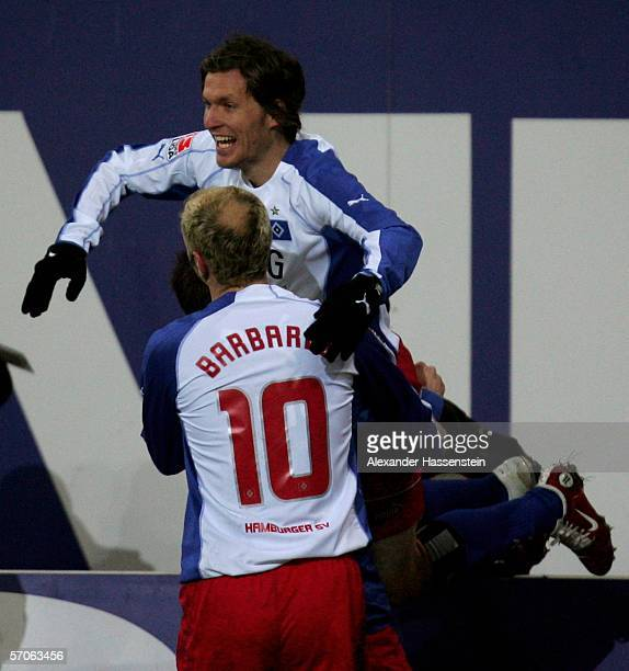 Benjamin Lauth of Hamburg celebrates scoring the first goal with his team mate Sergej Barbarez during the Bundesliga match between Hamburger SV and...