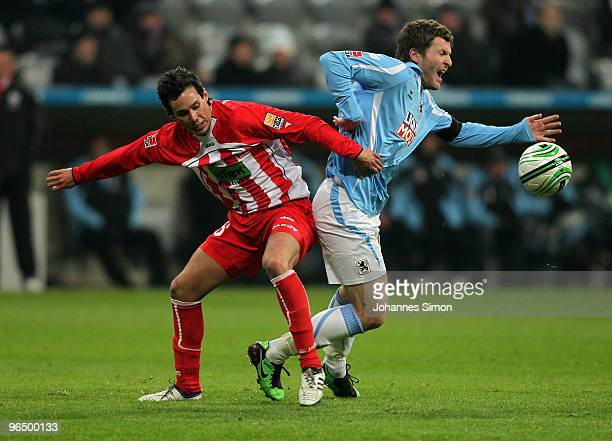 Benjamin Lauth of Muenchen battles for the ball with Tim Gorschlueter of Ahlen during the Second Bundesliga match between 1860 Muenchen and Rot Weiss...