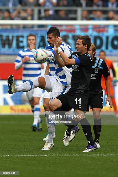 Benjamin Lauth of Muenchen blocks a shot of Juergen Gjasula of Duisburg during the Second Bundesliga match between MSV Duisburg and TSV 1860 Muenchen...
