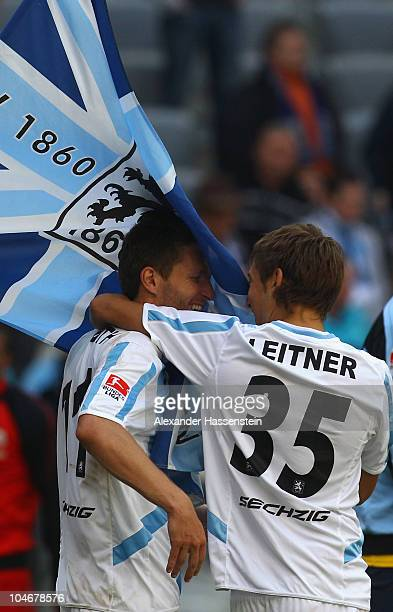 Benjamin Lauth of Muenchen celebrates victory with his team mate Stefan Aigner after the Second Bundesliga match between TSV 1860 Muenchen and Union...