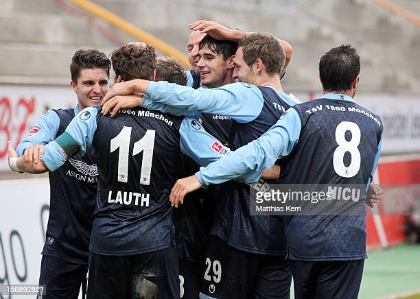 Benjamin Lauth of Muenchen jubilates with team mates after scoring the third goal during the Second Bundesliga match between 1.FC Union Berlin and...