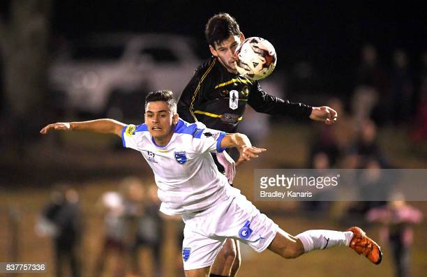 Benjamin Lyvidikos Gold Coast City and Corey Lucas of Moreton Bay challenge for the ball during the FFA Cup round of 16 match between Moreton Bay...
