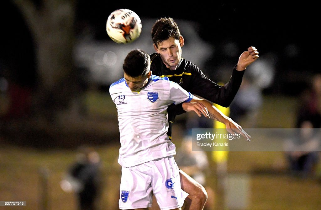 Benjamin Lyvidikos Gold Coast City and Corey Lucas of Moreton Bay challenge for the ball during the FFA Cup round of 16 match between Moreton Bay United and Gold Coast City at Wolter Park on August 23, 2017 in Brisbane, Australia.