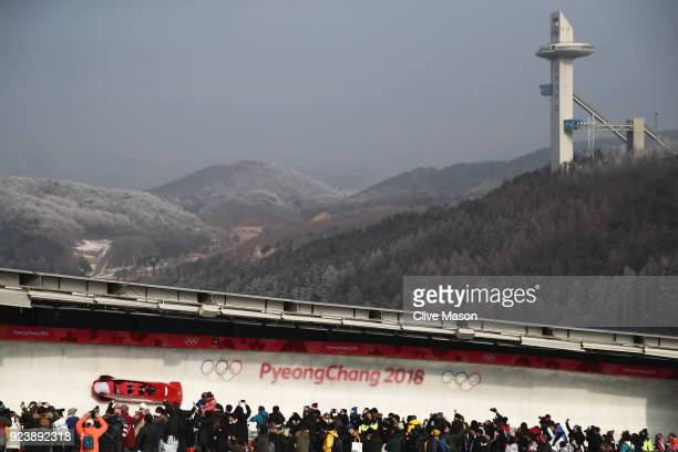 Benjamin Maier Kilian Walch Markus Sammer and Danut Ion Moldovan of Austria make a run during the 4man Boblseigh Heats on day sixteen of the...