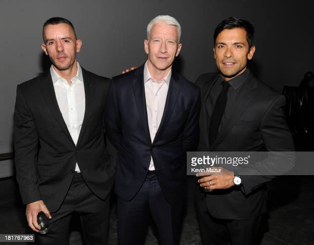 Benjamin Maisani Anderson Cooper and Mark Consuelos attend Madonna and Steven Klein secretprojectrevolution at the Gagosian Gallery on September 24...