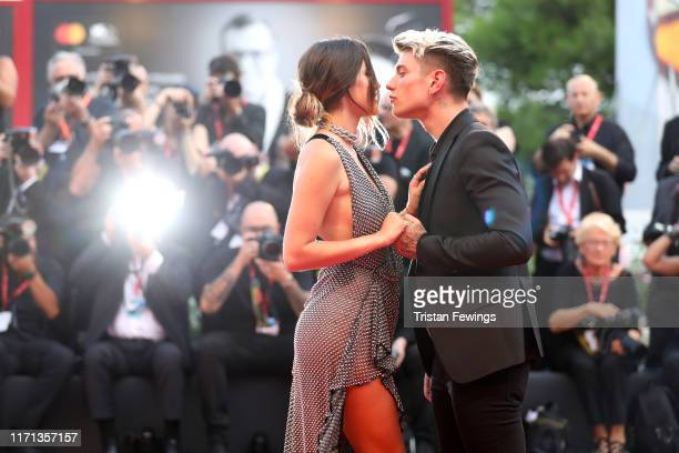 """Benjamin Mascolo knowns as Benji and Bella Thorne kiss on the red carpet ahead of the """"Joker"""" screening during the 76th Venice Film Festival at Sala..."""