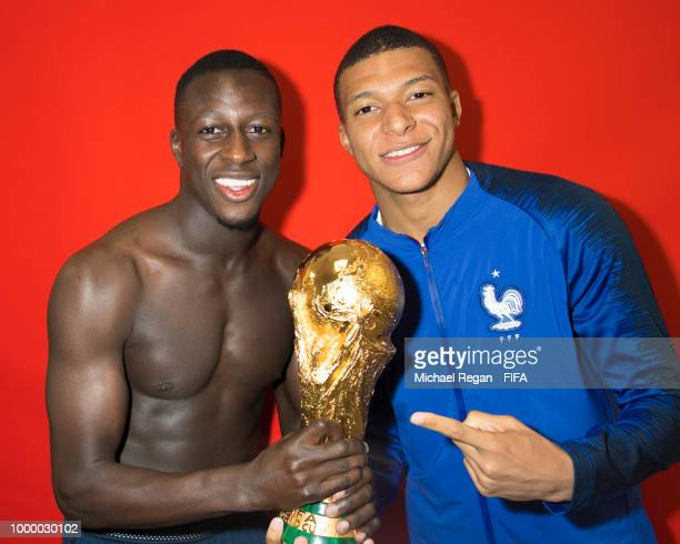 Benjamin Mendy and Kylian Mbappé of France pose with the Champions World Cup trophy after the 2018 FIFA World Cup Russia Final between France and...