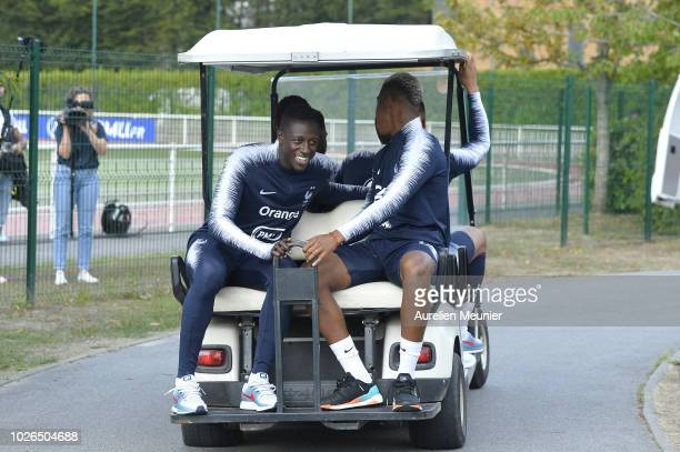 Benjamin Mendy and Presnel Kimpembe leave French Soccer team training session in a golf kart on September 3 2018 in EtivalClairefontaine France