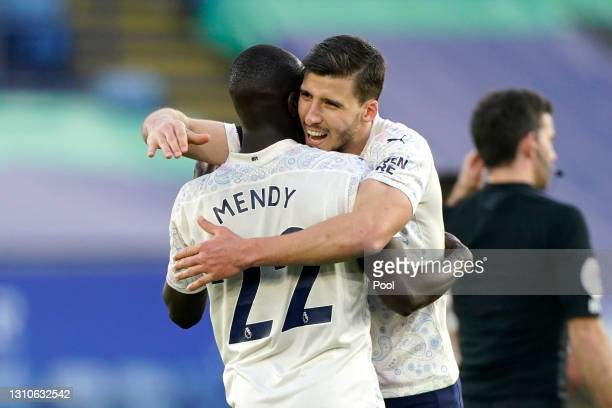 Benjamin Mendy and Ruben Dias of Manchester City celebrate following the Premier League match between Leicester City and Manchester City at The King...