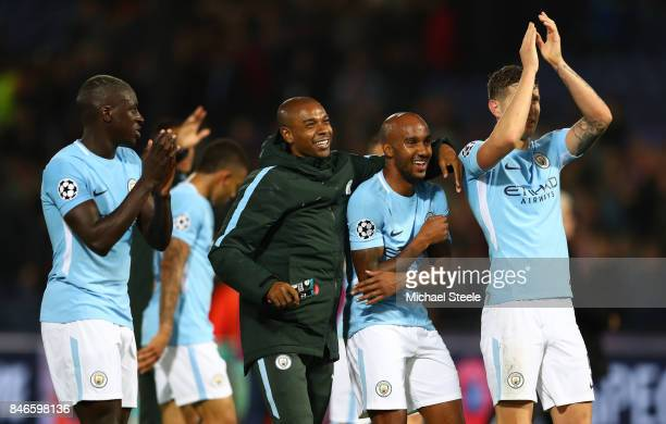 Benjamin Mendy Fernandinho Fabian Delph and John Stones of Manchester City celebrate vicotry after the UEFA Champions League group F match between...