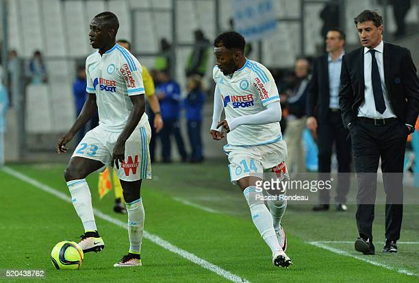Benjamin Mendy from Marseille with the ball in front team mate Georges Kévin Nkoudou Mbida and Marseille coach José Miguel Gonzales Martin Del Campo...