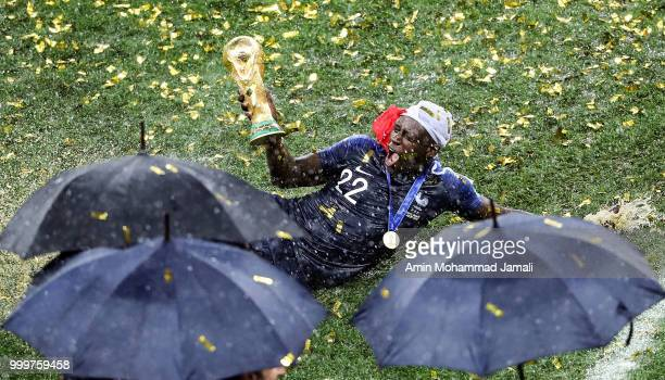 Benjamin Mendy holds up the trophy as he celebrates FIFA World Cup championship after the 2018 FIFA World Cup Russia Final between France and Croatia...