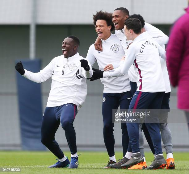 Benjamin Mendy Leroy Sane Tosin Adarabioyo Kyle Walker and Phil Foden reacts during training at Manchester City Football Academy on April 6 2018 in...