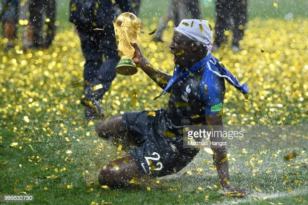 Benjamin Mendy of France celebrates with the World Cup Trophy following his sides victory in the 2018 FIFA World Cup Final between France and Croatia...