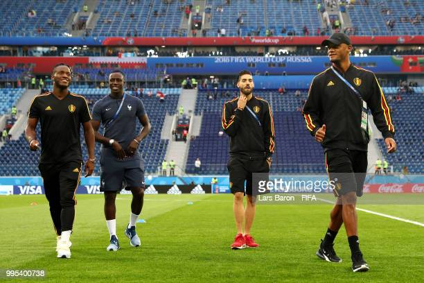 Benjamin Mendy of France speaks with Michy Batshuayi of Belgium during a pitch inspection prior to the 2018 FIFA World Cup Russia Semi Final match...