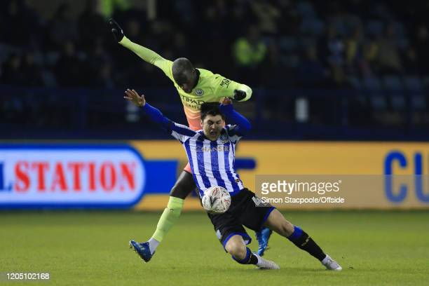 Benjamin Mendy of Man City battles with Fernando Forestieri of Sheff Wed during the FA Cup Fifth Round match between Sheffield Wednesday and...
