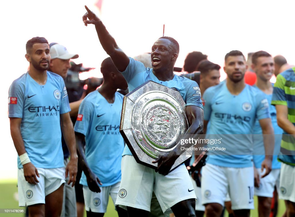 https://media.gettyimages.com/photos/benjamin-mendy-of-man-city-celebrates-with-the-trophy-during-the-fa-picture-id1011478296
