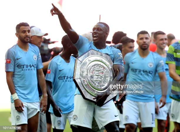 Benjamin Mendy of Man City celebrates with the trophy during the FA Community Shield match between Manchester City and Chelsea at Wembley Stadium on...