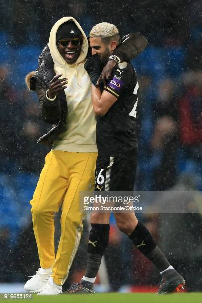 Benjamin Mendy of Man City shares a joke with Riyad Mahrez of Leicester at the end of the Premier League match between Manchester City and Leicester...