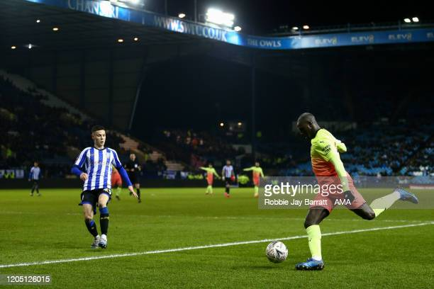 Benjamin Mendy of Manchester City and Alex Hunt of Sheffield Wednesday during the FA Cup Fifth Round match between Sheffield Wednesday and Manchester...
