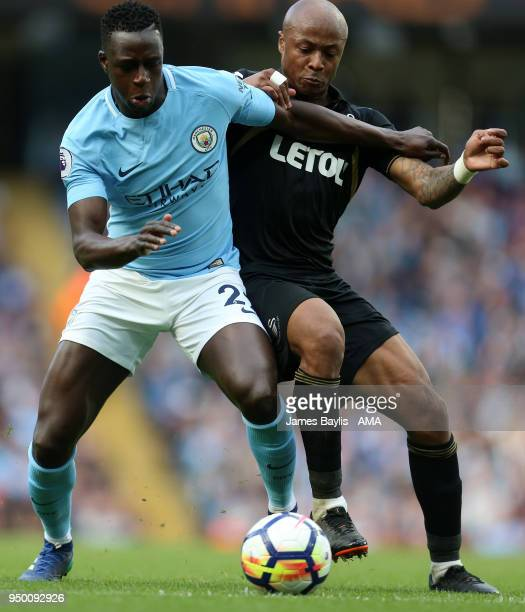 Benjamin Mendy of Manchester City and Andre Ayew of Swansea City during the Premier League match between Manchester City and Swansea City at Etihad...