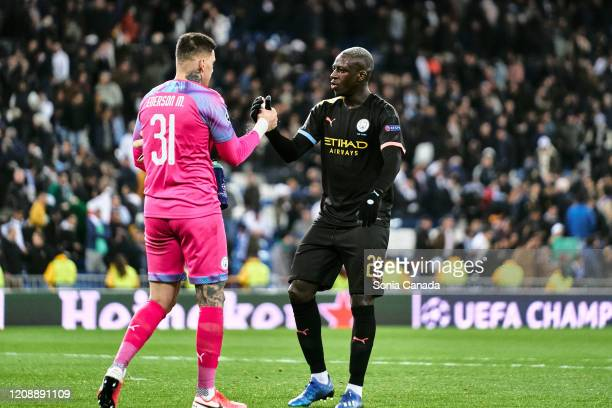 Benjamin Mendy of Manchester City and Ederson of Manchester City celebrate the vicotru of their team during the UEFA Champions League round of 16...
