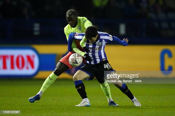 Benjamin Mendy of Manchester City and Fernando Forestieri of Sheffield Wednesday during the FA Cup Fifth Round match between Sheffield Wednesday and...