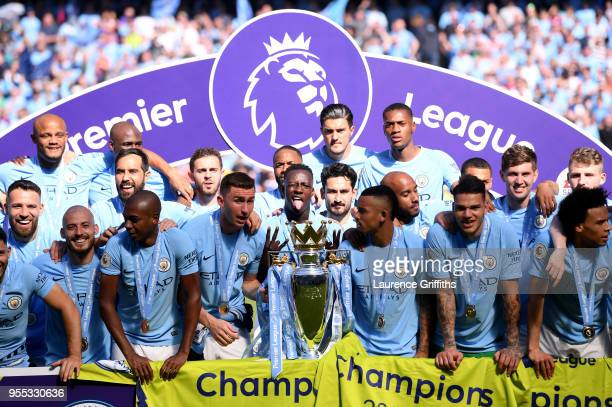 Benjamin Mendy of Manchester City and his team mates celebrate with The Premier League Trophy after the Premier League match between Manchester City...