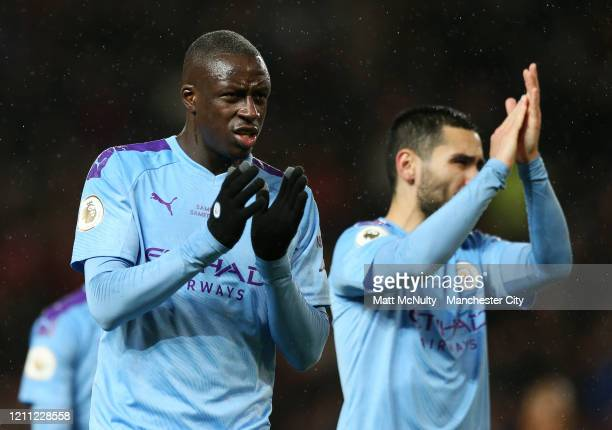 Benjamin Mendy of Manchester City applauds the fans at full time during the Premier League match between Manchester United and Manchester City at Old...