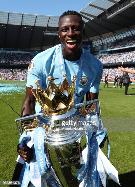 Benjamin Mendy of Manchester City celebrate with The Premier League Trophy after the Premier League match between Manchester City and Huddersfield...