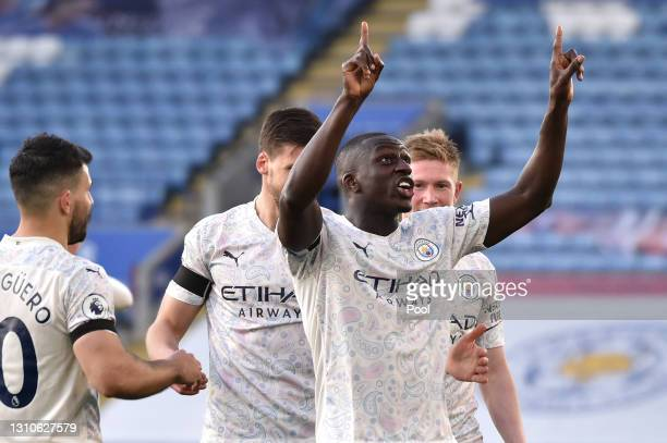 Benjamin Mendy of Manchester City celebrates after scoring their team's first goal during the Premier League match between Leicester City and...
