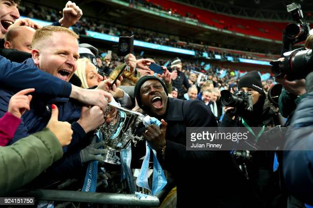 Benjamin Mendy of Manchester City celebrates after winning the Carabao Cup Final between Arsenal and Manchester City at Wembley Stadium on February...
