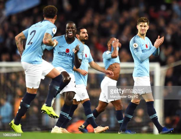 Benjamin Mendy of Manchester City celebrates victory with Kyle Walker of Manchester City as John Stones of Manchester City looks on after the Premier...