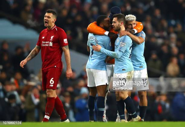 Benjamin Mendy of Manchester City celebrates victory with Raheem Sterling of Manchester City Bernardo Silva of Manchester City and Sergio Aguero of...