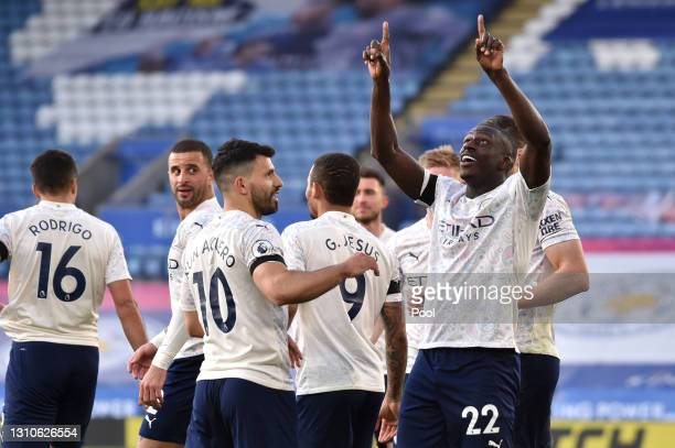 Benjamin Mendy of Manchester City celebrates with Sergio Aguero and teammates after scoring their team's first goal during the Premier League match...