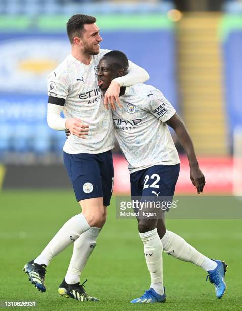 Benjamin Mendy of Manchester City celebrates with team mate Aymeric Laporte after scoring their side's first goal during the Premier League match...