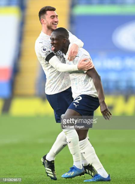 Benjamin Mendy of Manchester City celebrates with teammate Aymeric Laporte after scoring their team's first goal during the Premier League match...