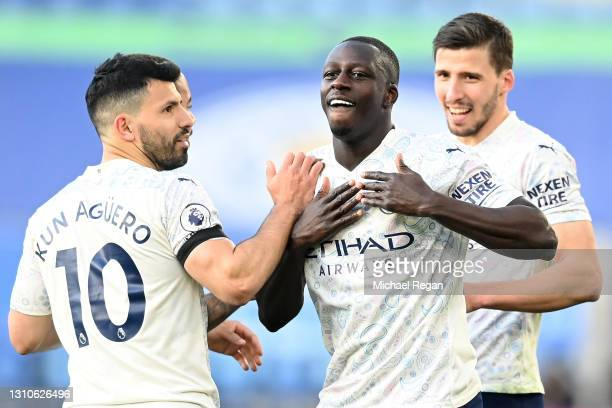 Benjamin Mendy of Manchester City celebrates with teammate Sergio Aguero after scoring their team's first goal during the Premier League match...